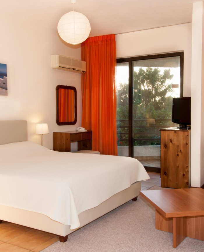 double bed in a spacious quadruple room in greece