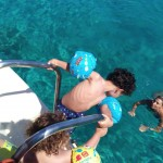 family diving and snorkeling in peloponnese