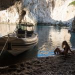 Boat trip Corinthian Gulf. Visit remote beaches. Organised by Lido Seaside Hotel